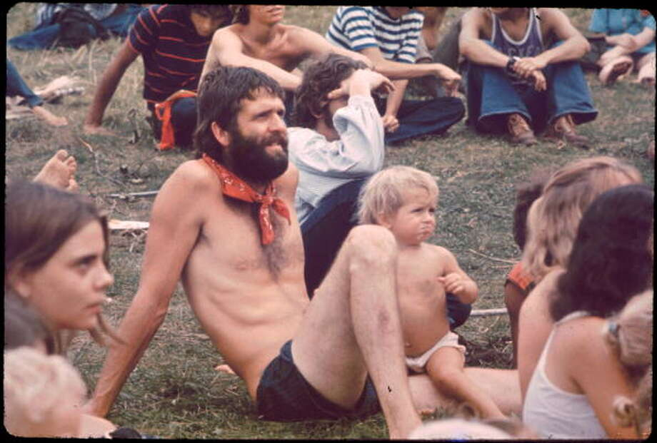 Ken Babbs, one of the Merry Pranksters, in the Free Stage audience watching the puppet show at the Woodstock music festival, August 1969. Photo: Ralph Ackerman, Getty Images / Hulton Archive