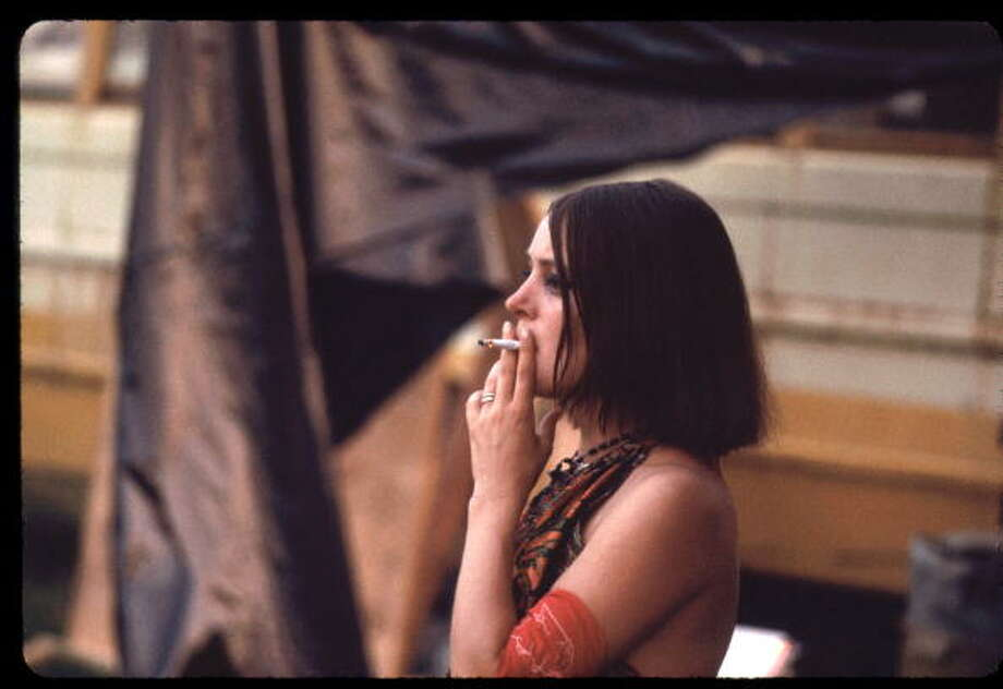 Hog Farmer tambourine player smoking a cigarette at at the Woodstock music festival, August 1969. Photo: Ralph Ackerman, Getty Images / Copyright 2009 Pat Ackerman