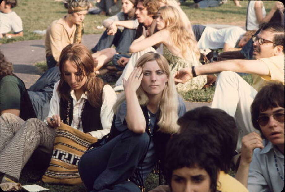 View of a large group of young men and women as they sit on the grass and wait for a bus to take them to the Woodstock Music and Arts Fair, New York, August 1969. The festival ran from August 15 to 18. Photo: Ralph Ackerman, Getty Images / Hulton Archive