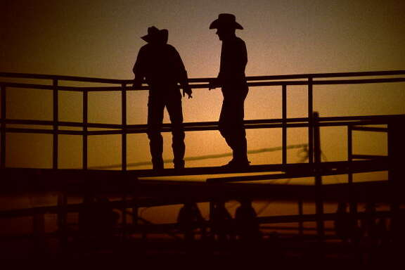 Unidentified Rodeo fans watch at a Rodeo on July 13, 1998 in Brownsville, Texas, USA. They attended a yearly rodeo held at a local stadium. Rodeo is one of the most popular pastimes in this area