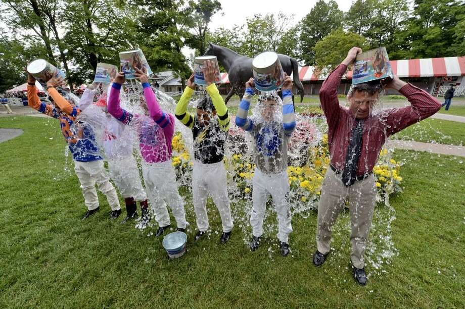 The country's top jockeys took the ice bath for ALS awareness Friday in the paddock at Saratoga Race Course.  (Skip Dickstein / Times Union)