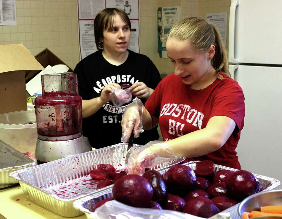 Barbara Maciag of Clifton Park, left, and Elizabeth Maciag of Clifton Park, right, help prepare beets for the 29th annual Polish American Harvest Festival at the Church of St Adalbert on Friday, August 15, 2014, in Schenectady N.Y. The festival starts Saturday 2-8 p.m. and continues Sunday at 12-7:30 p.m. (Selby Smith/Special to the Times Union) Photo: Selby Smith / 00028125A
