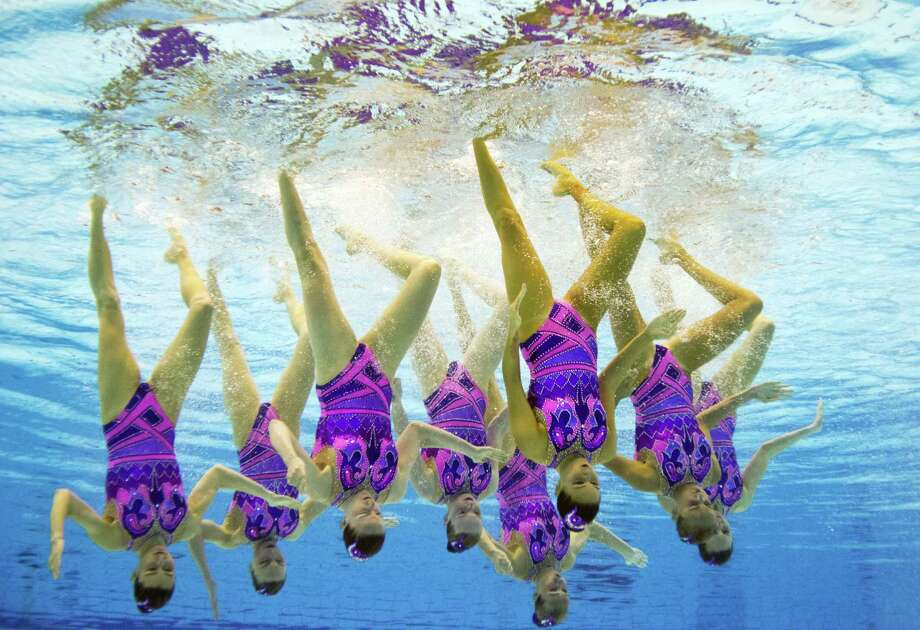 This picture taken with an underwater camera shows Ukraine's team competing in the synchronised swimming team free preliminary event at the 32nd LEN European swimming championships on August 14, 2014 in Berlin. AFP PHOTO / DAMIEN MEYERDAMIEN MEYER/AFP/Getty Images ORG XMIT: 506786477 Photo: DAMIEN MEYER, Getty / AFP