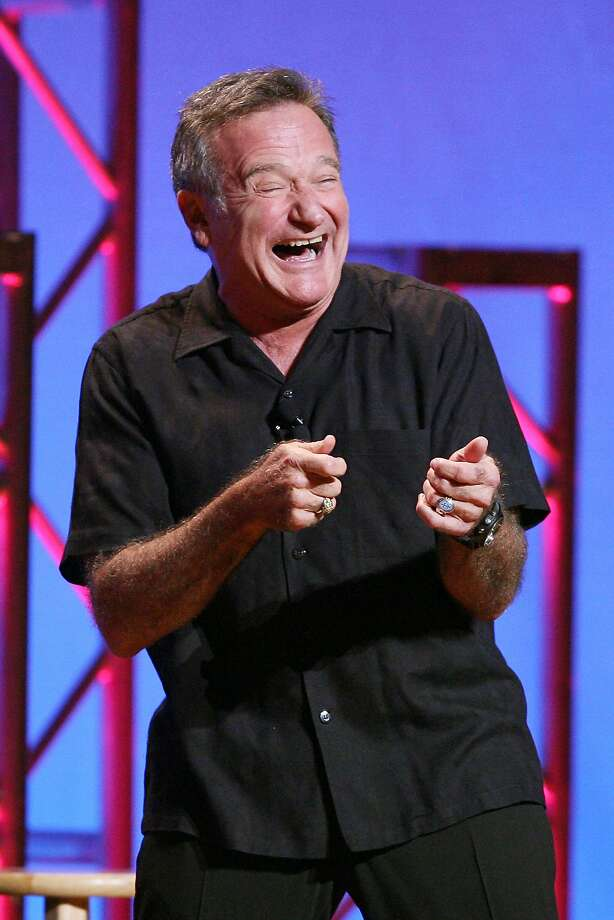 "This Nov. 23, 2009 photo released by Starpix shows actor-comedian Robin Williams performing his stand-up show, ""Weapons of Self Destruction,"" at Town Hall in New York. Williams' wife Susan Schneider released a statement Thursday, Aug. 14, 2014 announcing that Williams had early stages of Parkinson's disease. He died Monday of an apparent suicide at the age of 63. (AP Photo/Starpix, Dave Allocca) Photo: Dave Allocca, Associated Press"