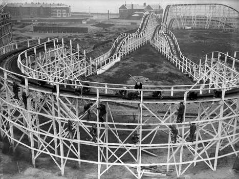 Men work on the big dipper at a Blackpool amusement park in 1934. Photo: Reg Speller, Getty Images / Hulton Archive