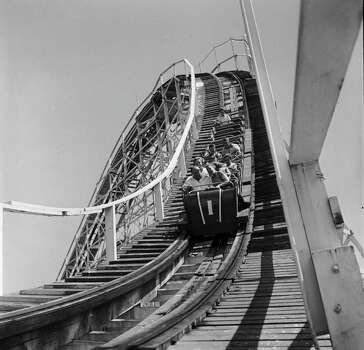 A roller-coaster gathers speed and momentum at Palisades Park, N.J., circa 1955. Photo: Orlando, Getty Images / Hulton Archive