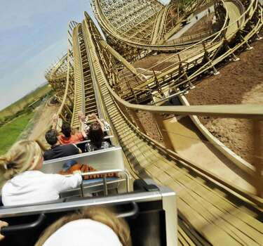 Visitors speed along a roller coaster called Mammut during its inauguration on April 27, 2008, at the Tripsdrill amusement park in Cleebronn, Germany. The coaster was built out of 70,000 pieces of wood, representing 3,000 to 4,000 trees. Photo: THOMAS LOHNES, AFP/Getty Images / 2008 AFP