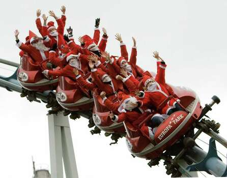 Men and women dressed as Santa Claus ride a roller coaster at the Europa entertainment park in Rust, Germany, in 2007. Photo: MICHAEL LATZ, AFP/Getty Images / 2007 AFP