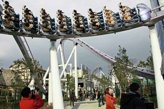 People ride on theHollywood Dream the Ride coaster at Universal Studios Japan, in Osaka in 2007. Photo: AFP, AFP/Getty Images / 2010 AFP