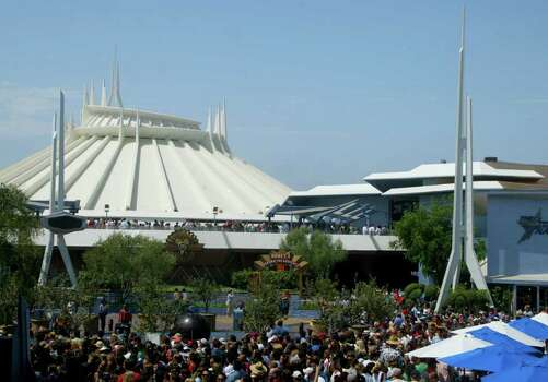 Crowds gather outside the re-launch ceremony of Disneyland's Space Mountain on July 15, 2005, in Anaheim, Calif. Photo: Matthew Simmons, Getty Images / 2005 Getty Images