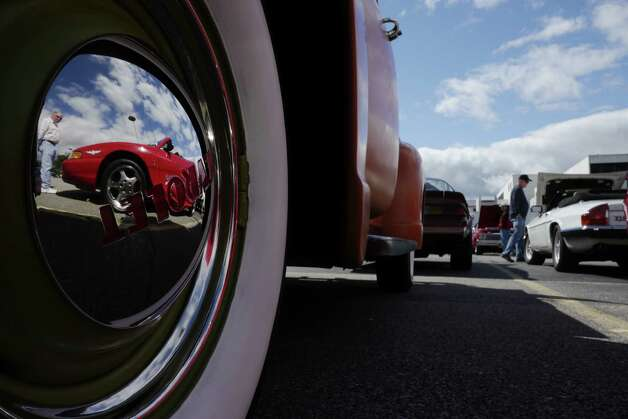 The hub cap on a 1953 Chevrolet pickup truck reflects a Ford Cobra that was the 1994 official pace car of the Indianapolis 500 at the 2013 Times Union Car Show.  (Paul Buckowski / Times Union) ORG XMIT: MER2013092216190378 Photo: Paul Buckowski / 00023756A