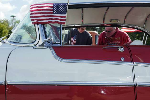 Tony Fabiano, left, from Hudson and Neil Van Allen from Kinderhook, look over a 1955 Oldsmobile at the 2013 Times Union Car Show.  (Paul Buckowski / Times Union) ORG XMIT: MER2013092216185875 Photo: Paul Buckowski / 00023756A