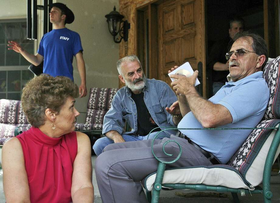 FILE - In this June 18, 2007, file photo, Ed Brown, right, and his wife Elaine Brown listen to Ruby Ridge survivor Randy Weaver, center, at their home in in Plainfield, N.H. The tax-evading couple are serving lengthy sentences after being convicted of amassing an arsenal of weapons and holding law enforcement at bay for nine months in 2007. Federal officials are set to auction on Friday, Aug. 15, 2014, the Brown's former fortress-like home sitting on more than 100 acres in Plainfield. Prospective bidders have not been allowed to tour the property. The U.S. Marshals Service cited the possibility of land mines and other explosives buried on the property as a complication. (AP Photo/Jim Cole, File) Photo: Jim Cole, Associated Press