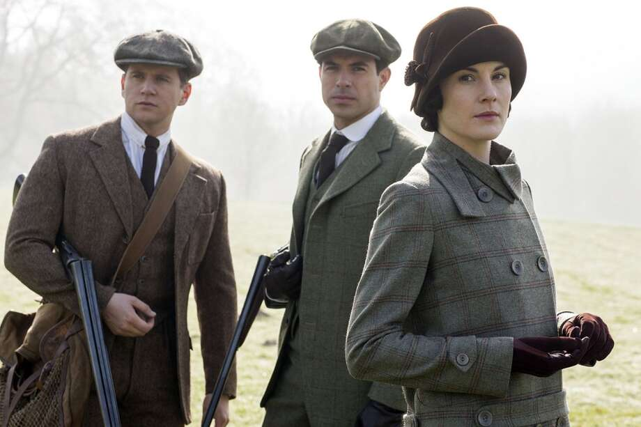 Downton Abbey returns in the U.S. on Jan. 4, 2015. Here's a first peek at Season 5, which is set in 1924. Will Lady Mary (Michelle Dockery, right) and Lord Gillingham (Tom Cullen, center) finally get together? Also pictured is Allen Leech as Tom Branson, left. Photo: Nick Briggs/Carnival Films 2014 For MASTERPIECE