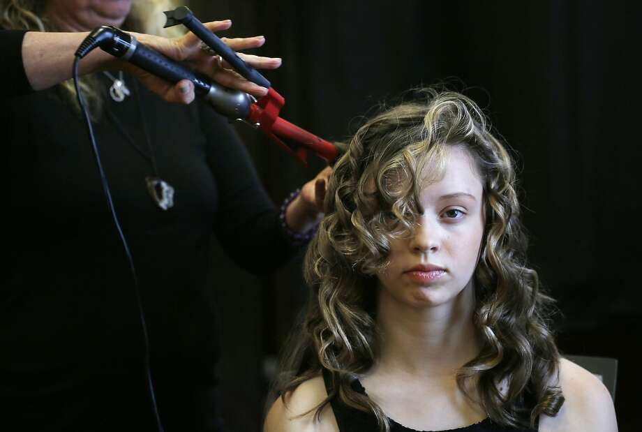 Rachel Combs, 13, gets her hair and makeup done for her Modeling Camp photo shoot in San Francisco. Photo: Mike Kepka