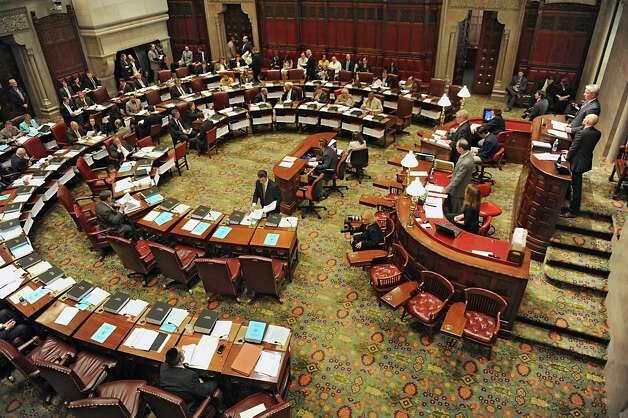 Senators continue to vote on bills Monday, June 16, 2014, at the Capitol  in Albany, N.Y.  (Lori Van Buren / Times Union) Photo: Lori Van Buren / 00027380A