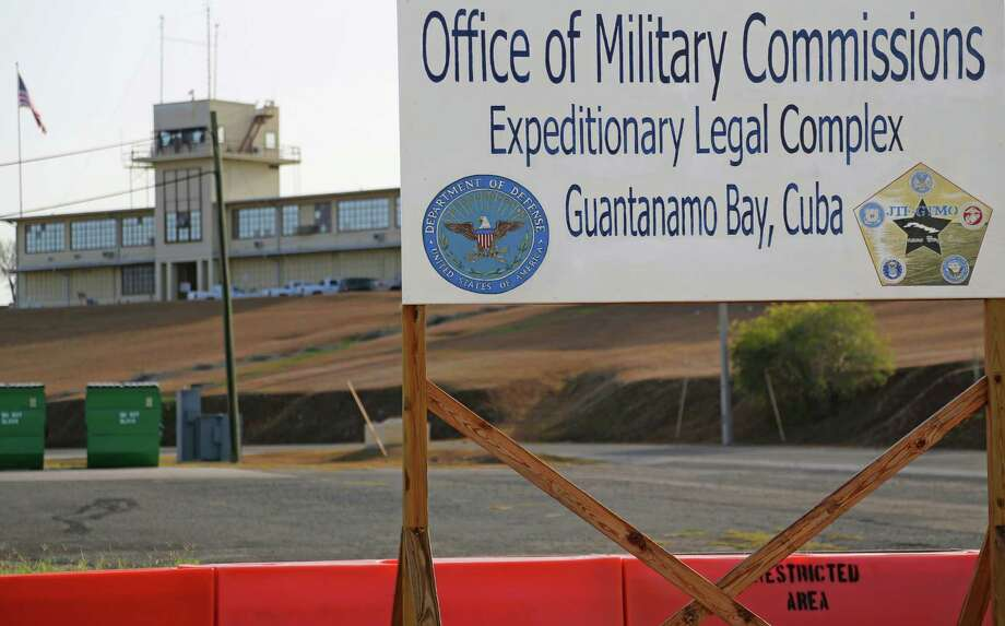 FILE - This June 17, 2013, file photo, shows a sign outside the Courthouse One Expeditionary Legal Complex at Naval Station Guantanamo Bay, Cuba. U.S. prosecutors are asking a military judge to reconsider his decision to try one of the men accused of plotting the Sept. 11 attack apart from the other four. Prosecutors have asked Army Col. James Pohl to hear arguments on their emergency motion involving Binalshibh first thing Monday, Aug. 11, 2014, at a pretrial hearing at the Guantanamo Bay naval base in Cuba. (AP Photo/Bill Gorman, File) ORG XMIT: WX112 Photo: Bill Gorman / AP