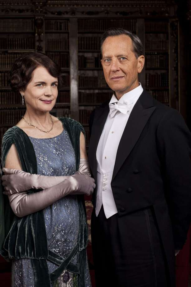 Richard E. Grant, right, joins Downton Abbey as Simon Bricker, who visits the Grantham estate with mysterious intentions. Also pictured:   Elizabeth McGovern as Cora. Photo: Nick Briggs/Carnival Films 2014 For MASTERPIECE