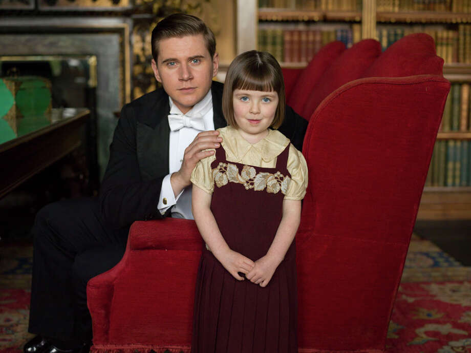 Baby Sibbie, right, is no longer a baby in Season 5 of Downton Abbey. She's played by Fifi Hart. Also pictured: Allen Leech as Tom Branson. Photo: Nick Briggs/Carnival Films 2014 For MASTERPIECE, © Carnival Film & Television Ltd / © Carnival Film & Television Ltd