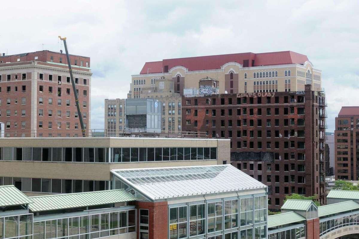 The Wellington Annex, right, on the site of Albany's future convention center at Howard and Eagle Streets on Friday Aug. 15, 2014, in Albany, N.Y. (Michael P. Farrell/Times Union)