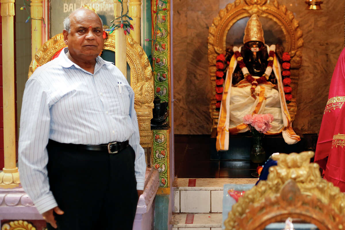 Mattur Balakrishna, (cq) stands beside the statue of Lord Krishna inside the Albany Hindu Temple, on August 13, 2014 in Loudonville, N.Y. (Tom Brenner/ Special to the Times Union)