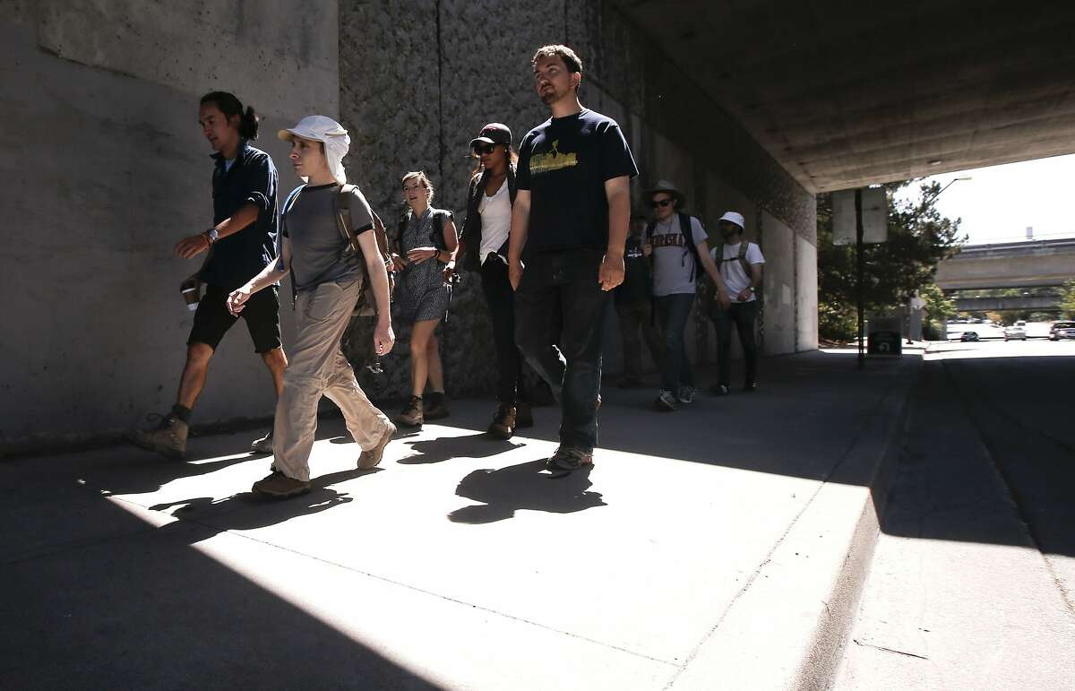 A group of Wanderers embark on their journey from the Orinda BART station on Saturday July 19, 2014, in Orinda, Calif. The Wanderers Union meets up from time to time for walks around the Bay Area that range anywhere from four to twenty four hours in length.