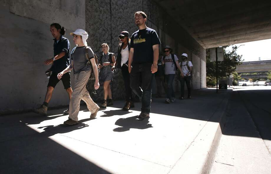 "A group embarks from the Orinda BART Station on a ""wandering,"" long walkabouts organized by the Wanderers Union. Photo: Michael Macor, The Chronicle"