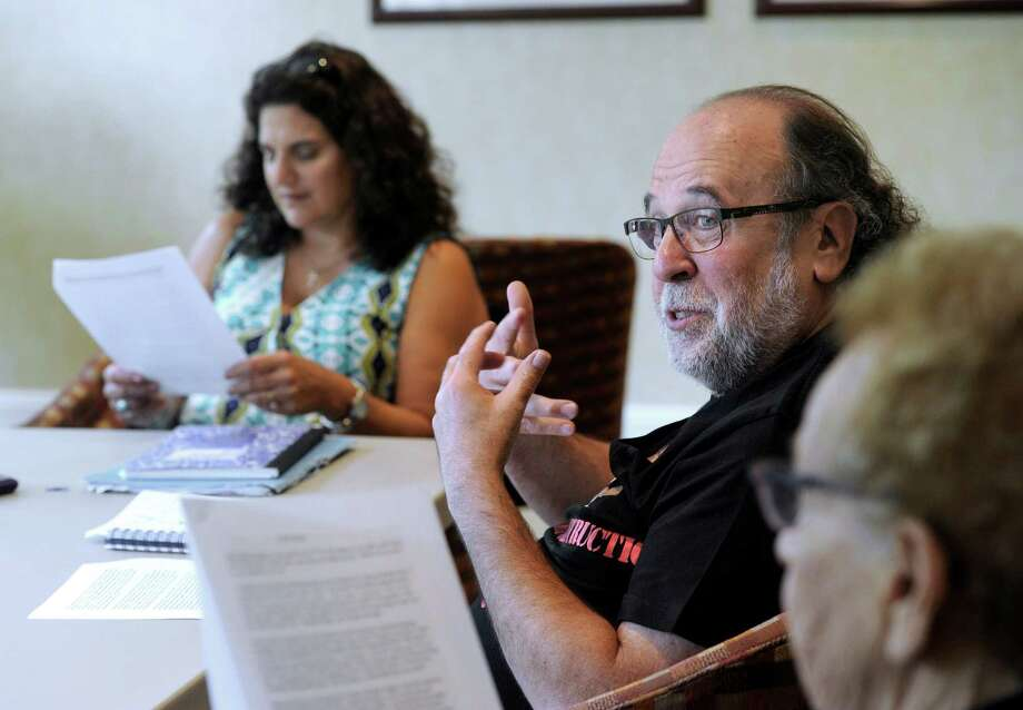 "Barry Schaffer, 66, of South Salem, N.Y., participates in a writing class Tuesday. Left is Cheryl Panosian Haddad, 52, of Danbury, the classes teacher. Seniors in Ridgefield, Conn., take a course called ""The Art of Writing"" at Founders Hall in Ridgefield, Conn., Tuesday, August 12, 2014. Photo: Carol Kaliff / The News-Times"