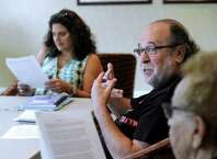 "Barry Schaffer, 66, of South Salem, N.Y., participates in a writing class Tuesday. Left is Cheryl Panosian Haddad, 52, of Danbury, the classes teacher. Seniors in Ridgefield, Conn., take a course called ""The Art of Writing"" at Founders Hall in Ridgefield, Conn., Tuesday, August 12, 2014."