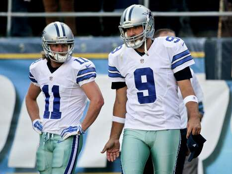 Dallas Cowboys quarterback Tony Romo and wide receiver Cole Beasley enter the field for warmups for a preseason NFL football game against the San Diego Chargers Thursday, Aug. 7, 2014, in San Diego. (AP Photo/Jae C. Hong) Photo: Jae C. Hong, Associated Press / AP
