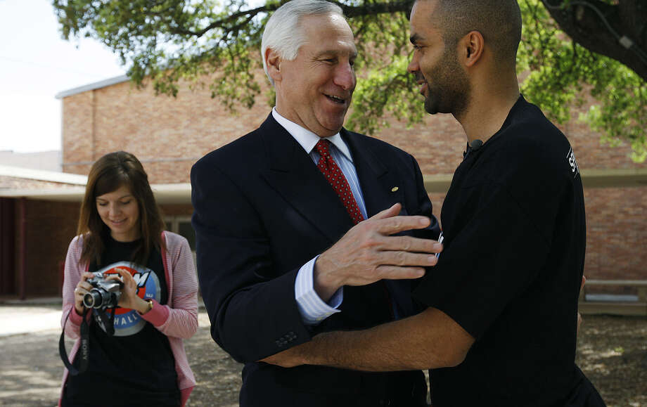 Charlie Amato, a Spurs shareholder, and Spurs point guard Tony Parker in 2011. Amato recently commented on the possibility of the Oakland Raiders relocating to San Antonio, and a reader wonders if the Spurs want the competition. Photo: Jerry Lara / San Antonio Express-News / SAN ANTONIO EXPRESS-NEWS
