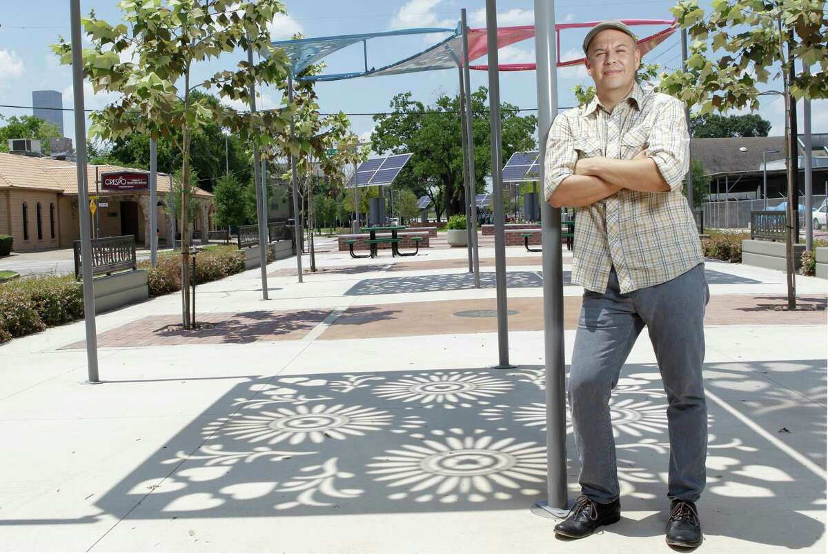 John Avila poses Wednesday, Aug. 13, 2014, in Houston along the Navigation Boulevard esplanade where he does pop-up barbecue from a food truck on Saturdays. ( Melissa Phillip / Houston Chronicle )