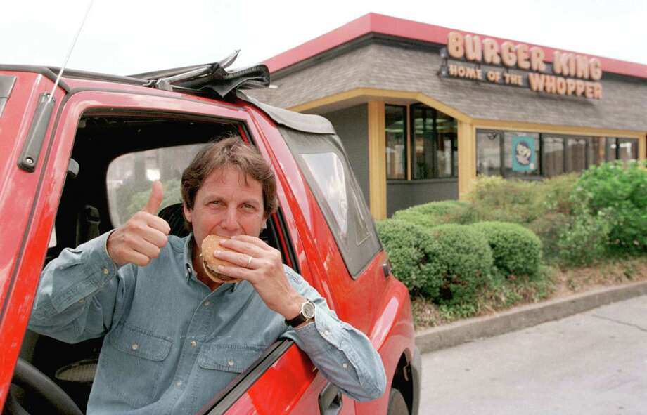 Ken Hoffman, the Drive-Thru Gourmet, in 1996 with one of his many burgers. Photo: Betty Tichich, STAFF / HOUSTON CHRONICLE