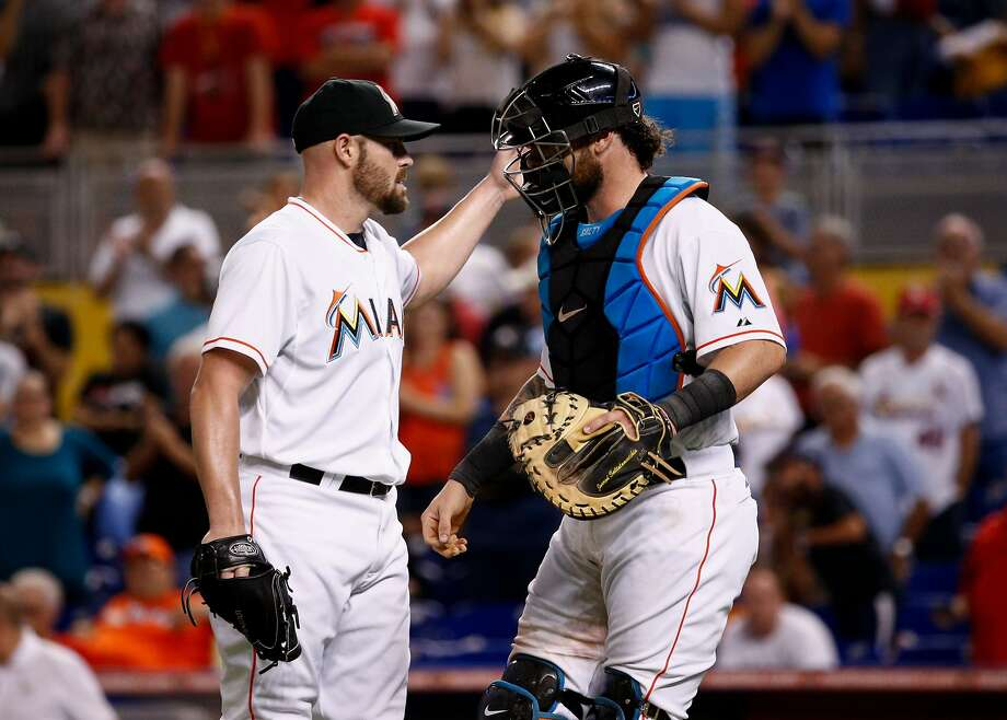 Mike Dunn (left) has 10 victories as a reliever this season for Miami. Photo: Rob Foldy, Getty Images