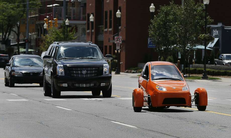 The three-wheeled Elio, which gets 49 mpg in the city and 84 mpg on the highway, will sell for $6,800. Photo: Paul Sancya, Associated Press