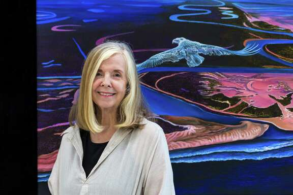 "Houston artist Lynn Randolph stands beside her painting ""Eagle Pneuma."""