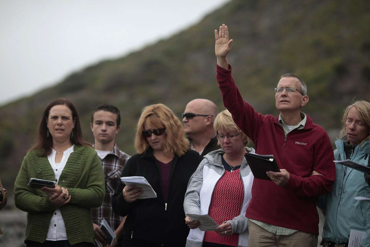 Lindsay Cutshall's father Chris prays at Goat Rock Beach on Friday, Aug. 14, 2014 in Jenner, Calif. Lindsay and her fiance were killed in Jenner ten years ago.