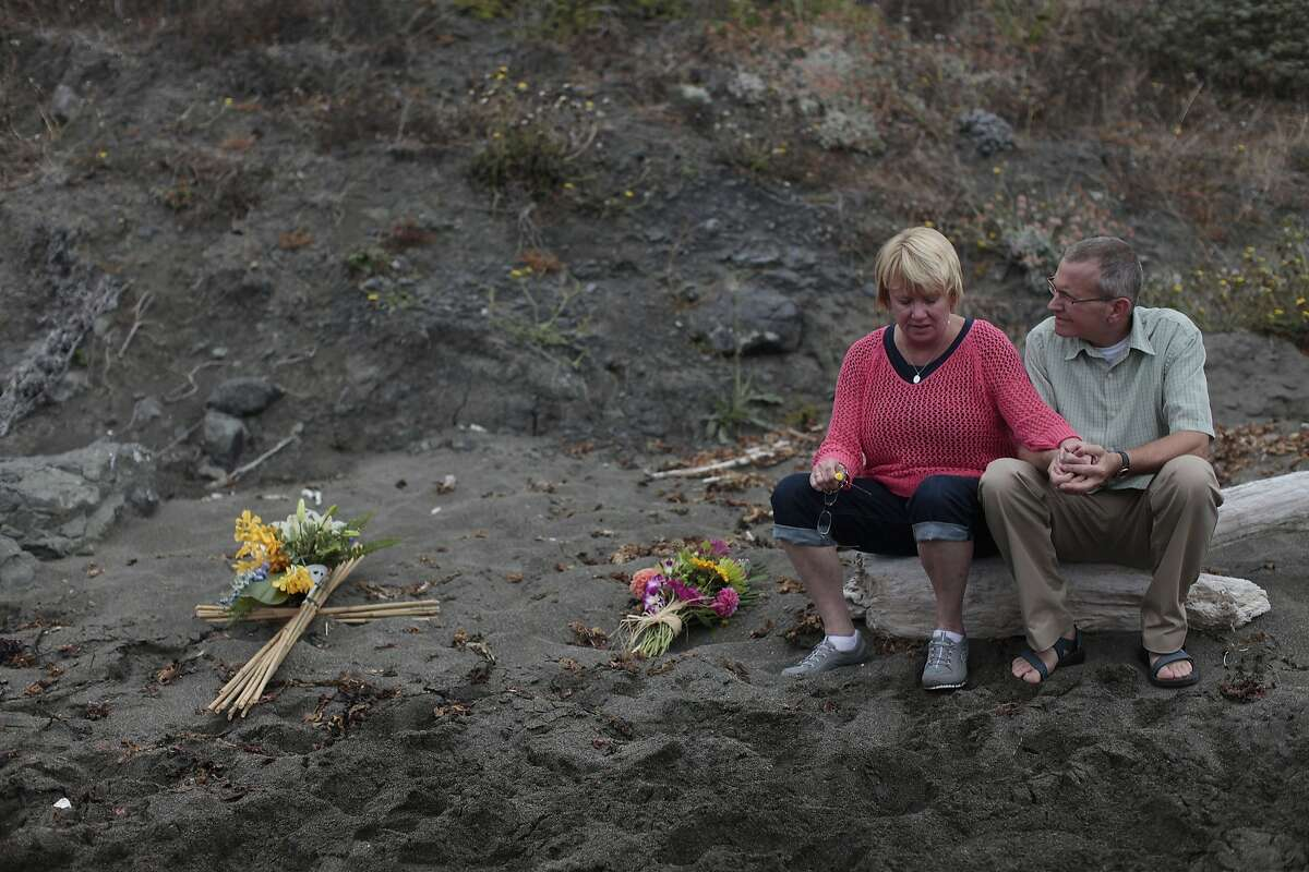 Kathy and Chris Cutshall take a moment at the spot where their daughter Lindsay and her fiance were killed on Friday, Aug. 14, 2014 in Jenner, Calif. Lindsay and her fiance were killed in Jenner ten years ago.