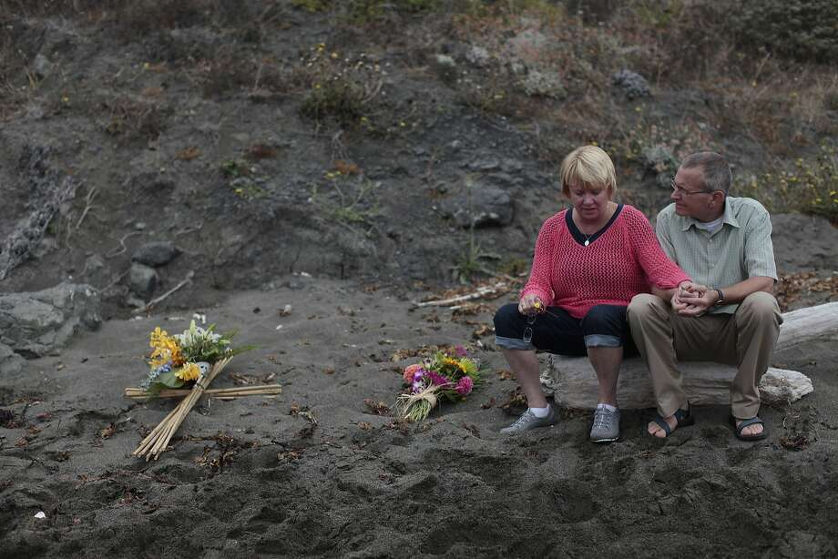Kathy and Chris Cutshall take a moment at the spot where daughter Lindsay and her fiance were killed. Photo: James Tensuan, The Chronicle