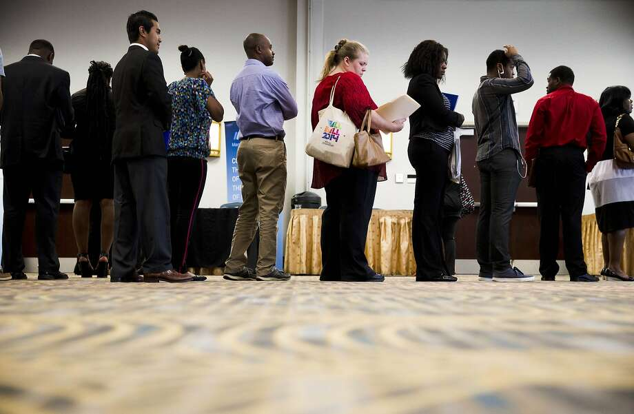 Job seekers wait to meet with recruiters during a job fair in Philadelphia. The Bureau of Labor Statistics said that employers reported in June that they had 4.5 million available jobs that they were unable to fill. Photo: Matt Rourke, Associated Press