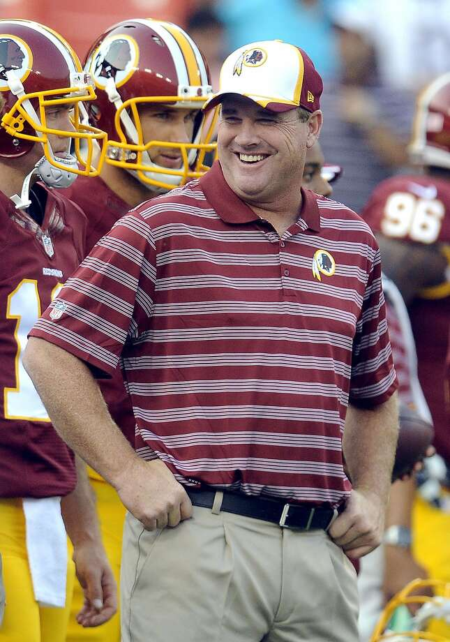 FILE - In this Aug. 7, 2014, file photo, Washington Redskins head coach Jay Gruden stands on the sidelines before an NFL football preseason game against the New England Patriots in Landover, Md. Unlike a year ago, when the Washington Redskins' star quarterback Robert Griffin III and then-head coach Mike Shanahan feuded openly about whether he'd be allowed to test his surgically repaired knee in a preseason game, Griffin and the Redskins wrapped up a drama-free camp under new coach Gruden. (AP Photo/Richard Lipski, File) Photo: Richard Lipski, Associated Press