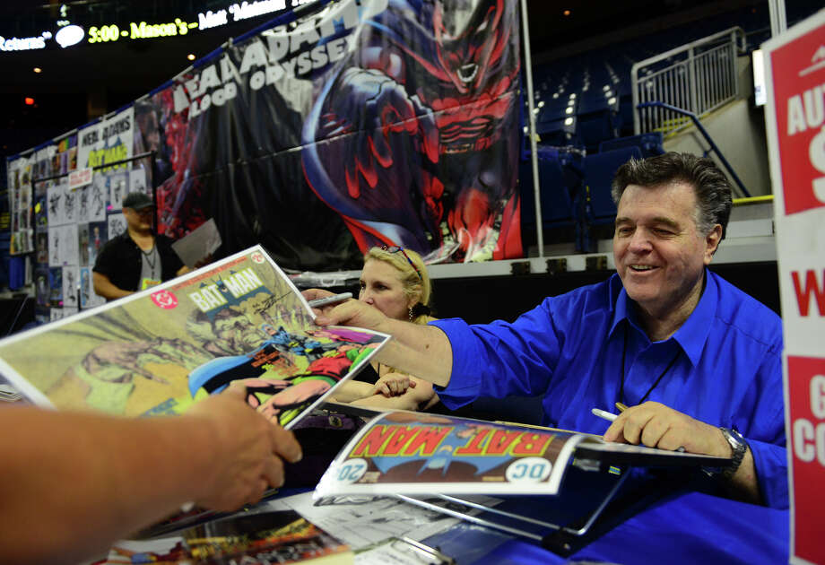 Legendary comic book artist Neal Adams signs autographs for his fans during Connecticut ComiCONN at the Webster Bank Arena in downtown Bridgeport, Conn. on Friday, August 15, 2014. ComiCONN continues through Sunday. Photo: Christian Abraham / Connecticut Post