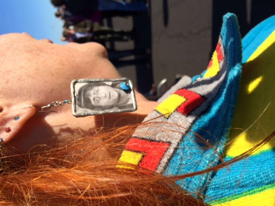 She even has John Lennon earrings with which to accessorize Photo: Leah Garchik