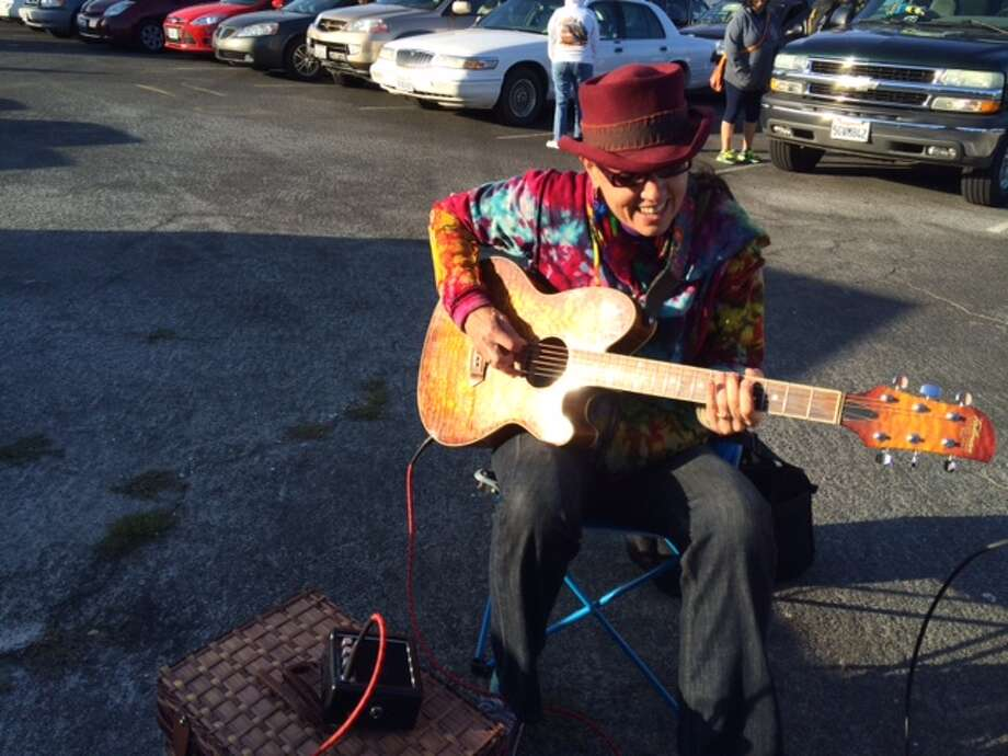 Groovy Judy came prepared to play in the parking lot Photo: Leah Garchik