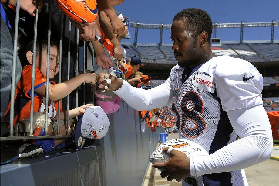 Denver linebacker Von Miller gives a fist bump to Romeo Ramirez, 4, this month. Photo: Chris Schneider, Associated Press