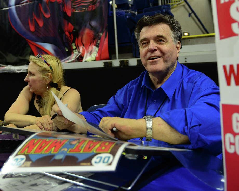 Legendary comic book artist Neal Adams signs autographs for his fans during Connecticut ComiCONN at the Webster Bank Arena in downtown Bridgeport, Conn. on Friday, August 15, 2014. Seated at left is Adams' wife Marilyn. Photo: Christian Abraham / Connecticut Post