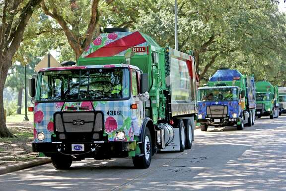 "In an effort to ""go green"" the Houston Art Alliance and the City of Houston Solid Waste Management reveal six Art-covered recycling trucks as part of the Art Recycling Truck Project at Hermann Park Wednesday, Aug. 13, 2014, in Houston, Texas. ( Gary Coronado / Houston Chronicle )"