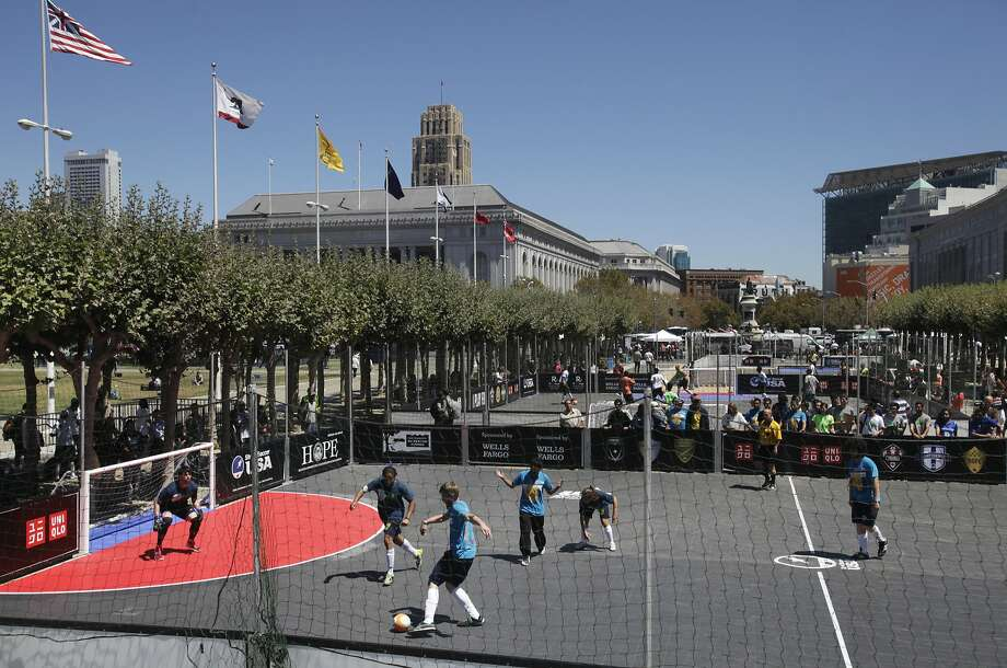 Members of the S.F. team play against Seattle during the Street Soccer USA National Cup in Civic Center Plaza. Sixteen cities compete for the win and to earn spots in the Homeless World Cup in Santiago, Chile. Photo: Leah Millis, The Chronicle