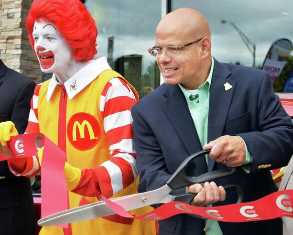 Ronald McDonald joins McDonald's owner/operator George Michell during the ribbon cutting at the grand re-opening of the Wolf Road McDonald's Friday August 15, 2014, in Colonie, NY.  (John Carl D'Annibale / Times Union) Photo: John Carl D'Annibale / 00028126A