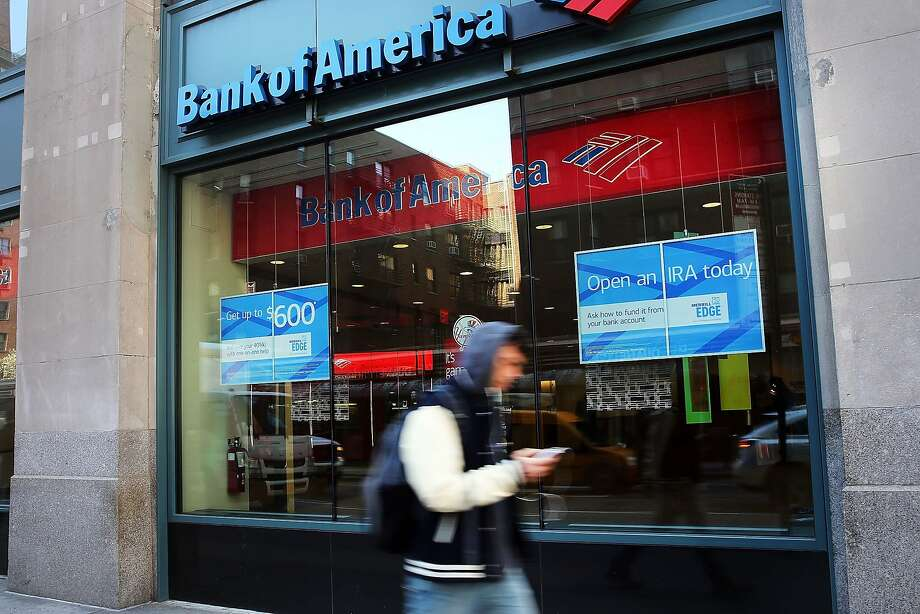 Bank of America may pay a settlement of more  than $16 billion over soured mortgage bonds. Photo: Spencer Platt, Getty Images